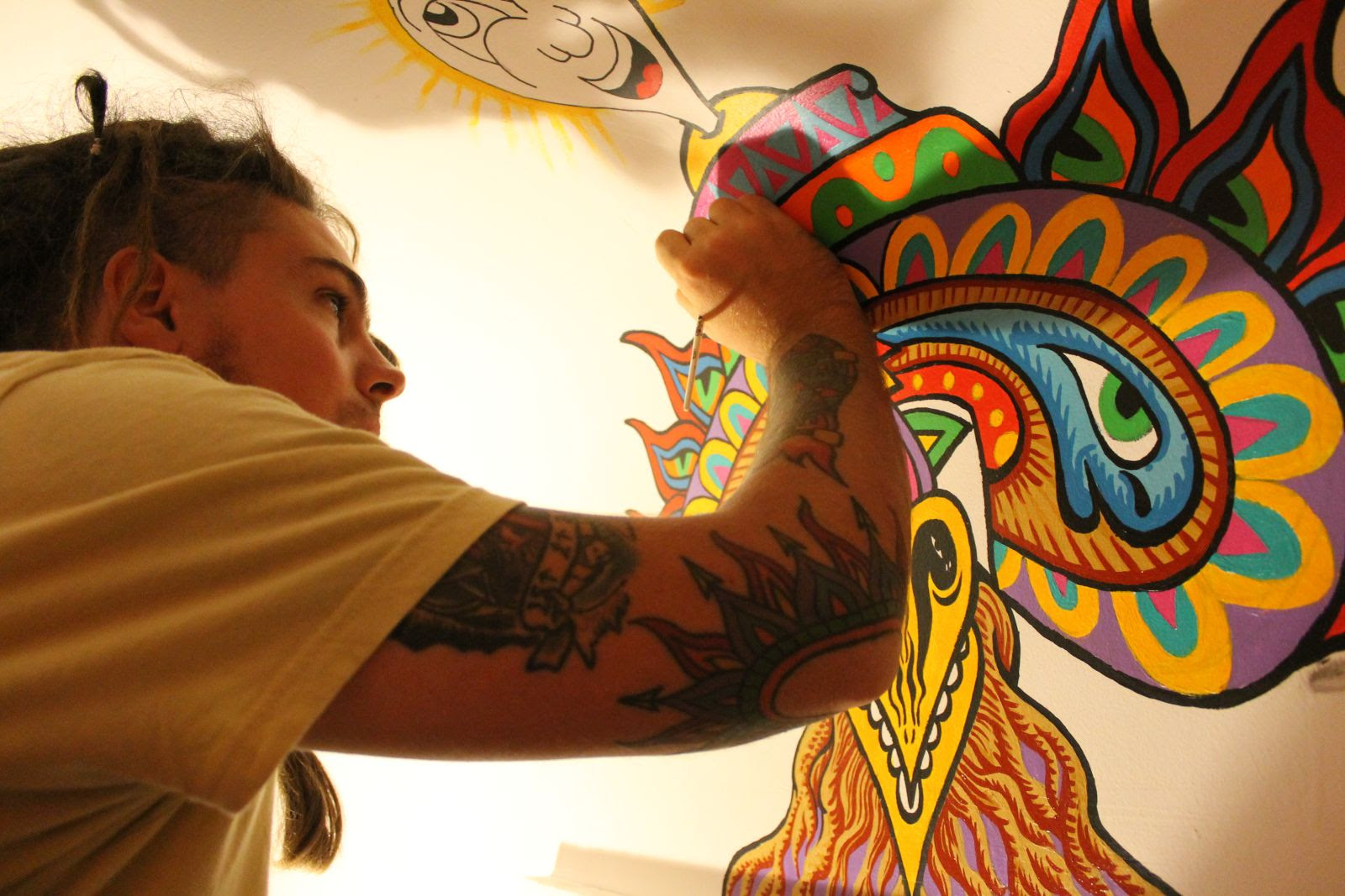 chris dyer muraling the mushroom cafe