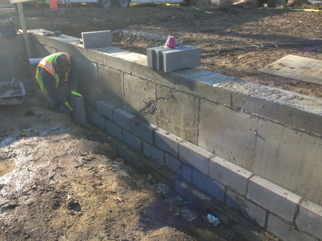 Block being laid to reinforce interior foundation walls of Entheon