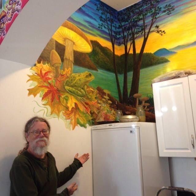 mark henson with mushroom cafe mural